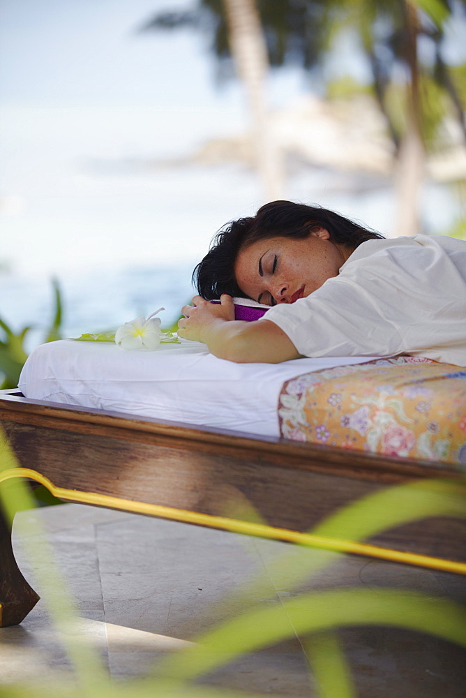 Woman relaxing on massage bed at Melati Beach Resort and Spa, Ko Samui, Thailand, Southeast Asia, Asia