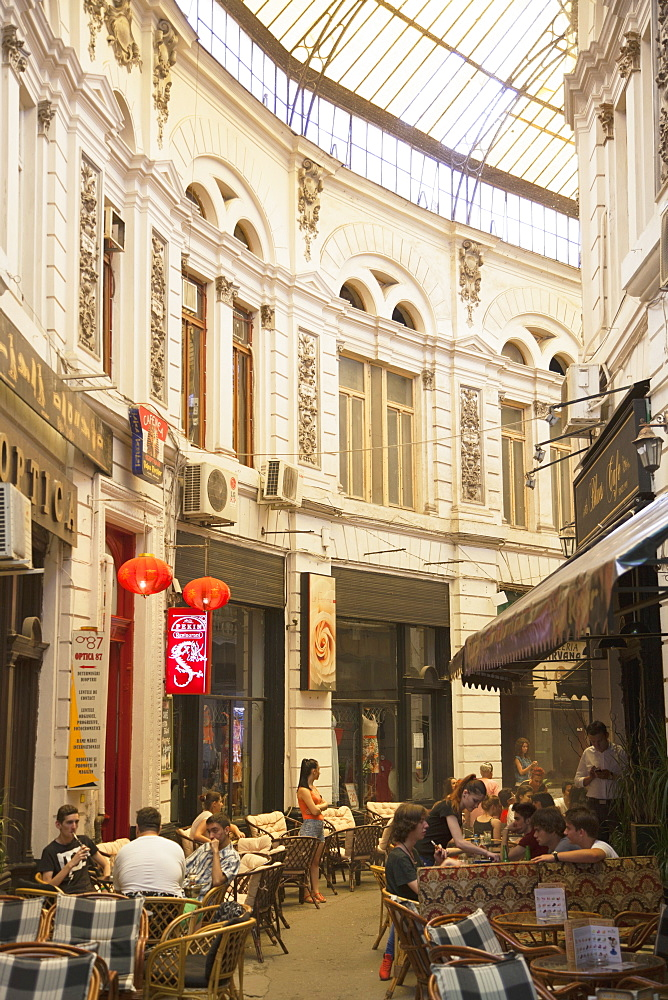 People at cafes in Macca-Villacrosse Passage, Bucharest, Romania, Europe