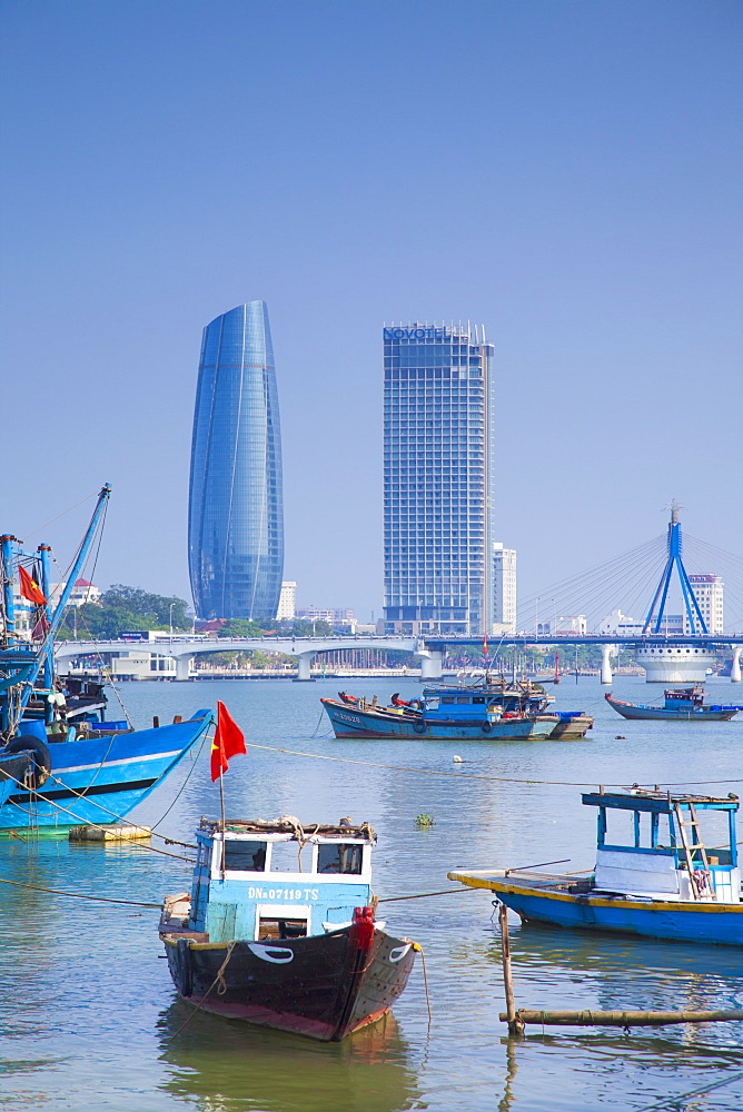 Fishing boats on Song River and city skyline, Da Nang, Vietnam, Indochina, Southeast Asia, Asia