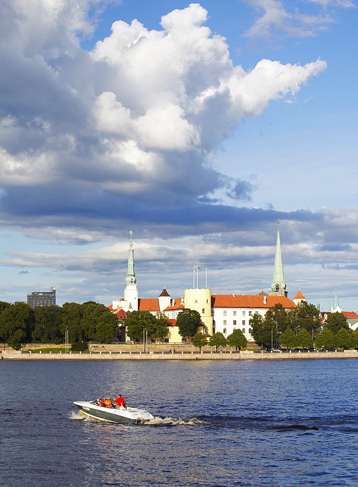 Speedboat on Daugava River with Riga Castle in background, Riga, Latvia, Baltic States, Europe