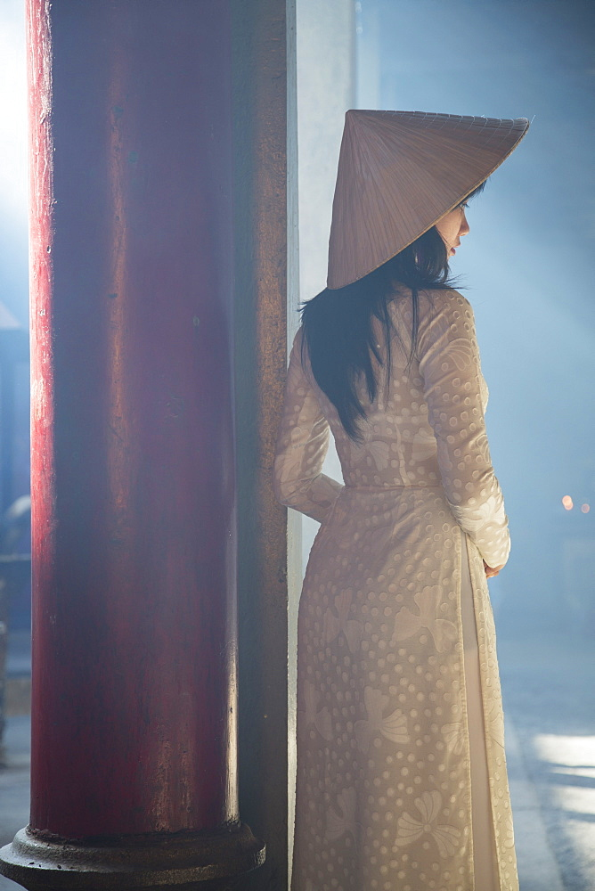 Woman wearing ao dai dress at Thien Hau Pagoda, Cholon, Ho Chi Minh City, Vietnam, Indochina, Southeast Asia, Asia