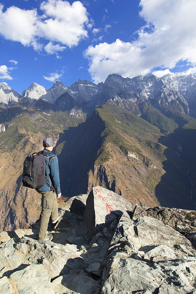Man hiking in Tiger Leaping Gorge, UNESCO World Heritage Site, with Jade Dragon Snow Mountain (Yulong Xueshan), Yunnan, China, Asia - 800-3006