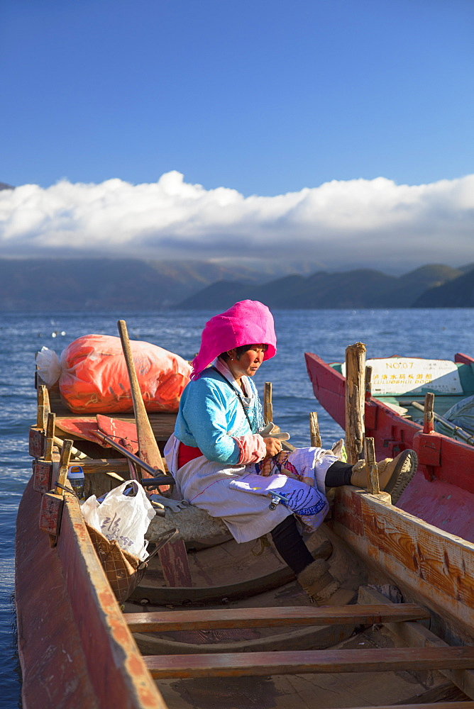 Mosu woman on boat, Luoshui, Lugu Lake, Yunnan, China, Asia - 800-3012