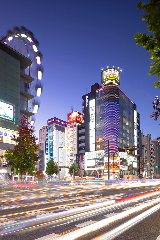Ferris wheel and shopping street at dusk, Nagoya, Honshu, Japan, Asia