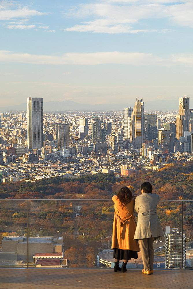 Couple on rooftop of Shibuya Scramble Square, Shibuya, Tokyo, Japan