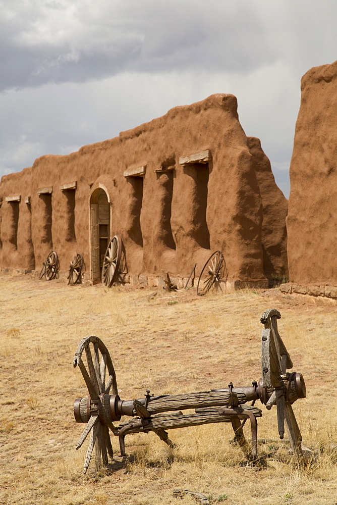 Old wagon wheels with remnants of Fort Union behind, Fort Union National Monument, New Mexico, United States of America, North America
