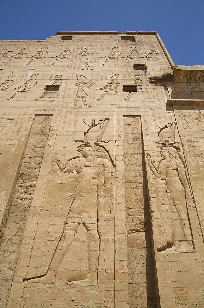 Relief depicting Horus on left, Pylon, Temple of Horus, Edfu, Egypt, North Africa, Africa