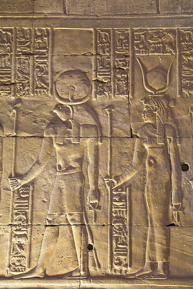 Relief depicting the God Horus on left and the Goddess Hathor on right, Temple of Horus, Edfu, Egypt, North Africa, Africa