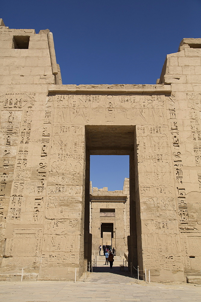 Doorway of First Pylon with view of doorway to Second Pylon, Medinet Habu (Mortuary Temple of Ramses III), West Bank, Luxor, Thebes, UNESCO World Heritage Site, Egypt, North Africa, Africa