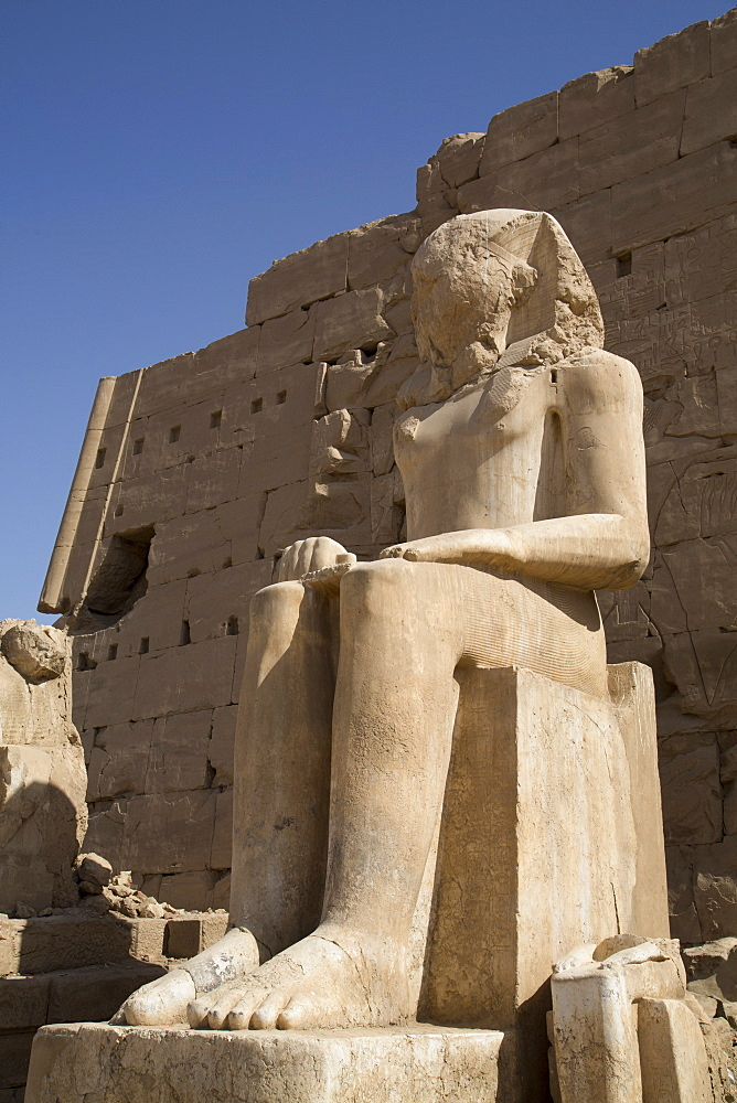Seated Colossus in front of 8th Pylon, Karnak Temple, Luxor, Thebes, UNESCO World Heritage Site, Egypt, North Africa, Africa