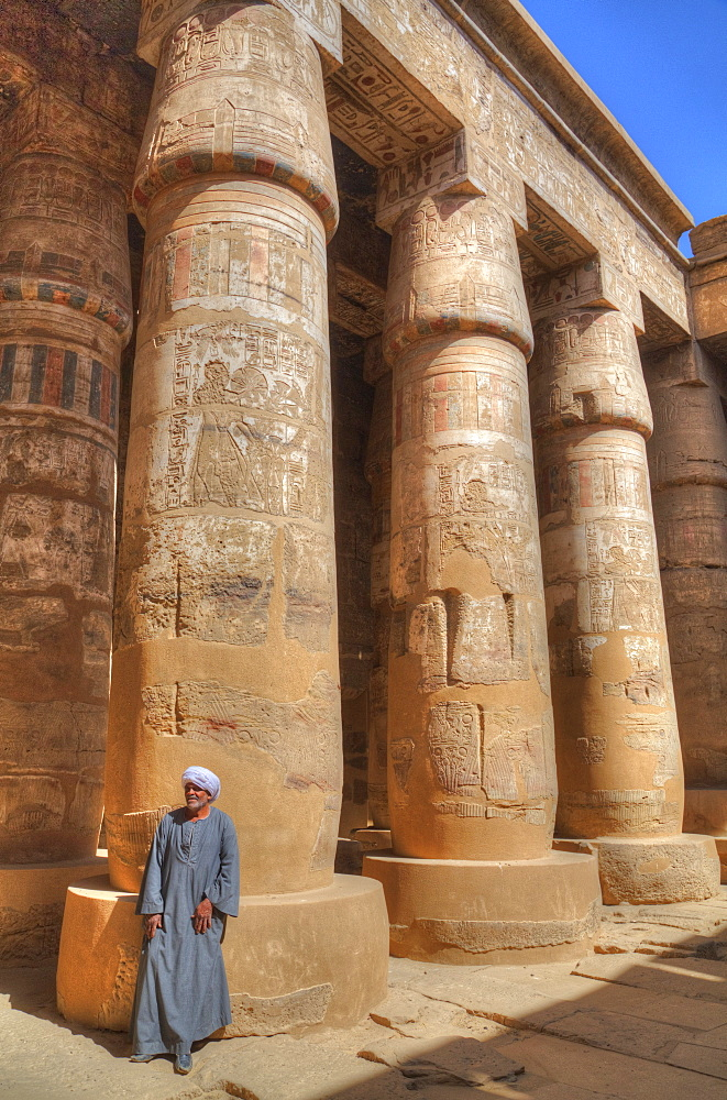 Local man, Columns in the Great Hypostyle Hall, Karnak Temple, Luxor, Thebes, UNESCO World Heritage Site, Egypt, North Africa, Africa