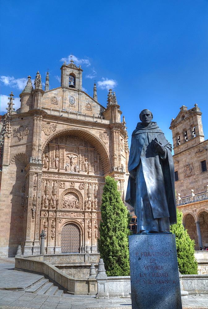 Statue of Francisco de Vitoria in foreground, Saint Stephen's Convent, Salamanca, UNESCO World Heritage Site, Castile y Leon, Spain, Europe