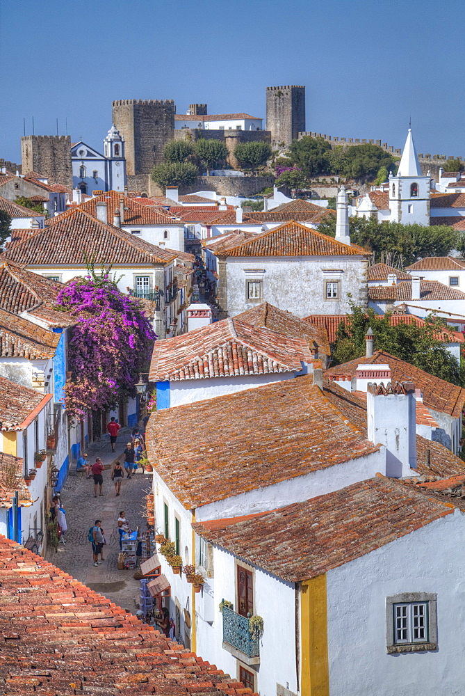 City overview with Medieval Castle in the background, Obidos, Portugal, Europe