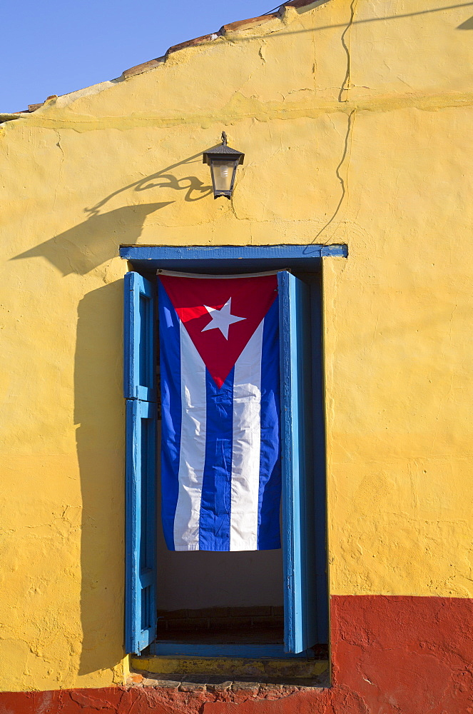 Cuban flag in doorway, Trinidad, UNESCO World Heritage Site, Sancti Spiritus, Cuba, West Indies, Central America