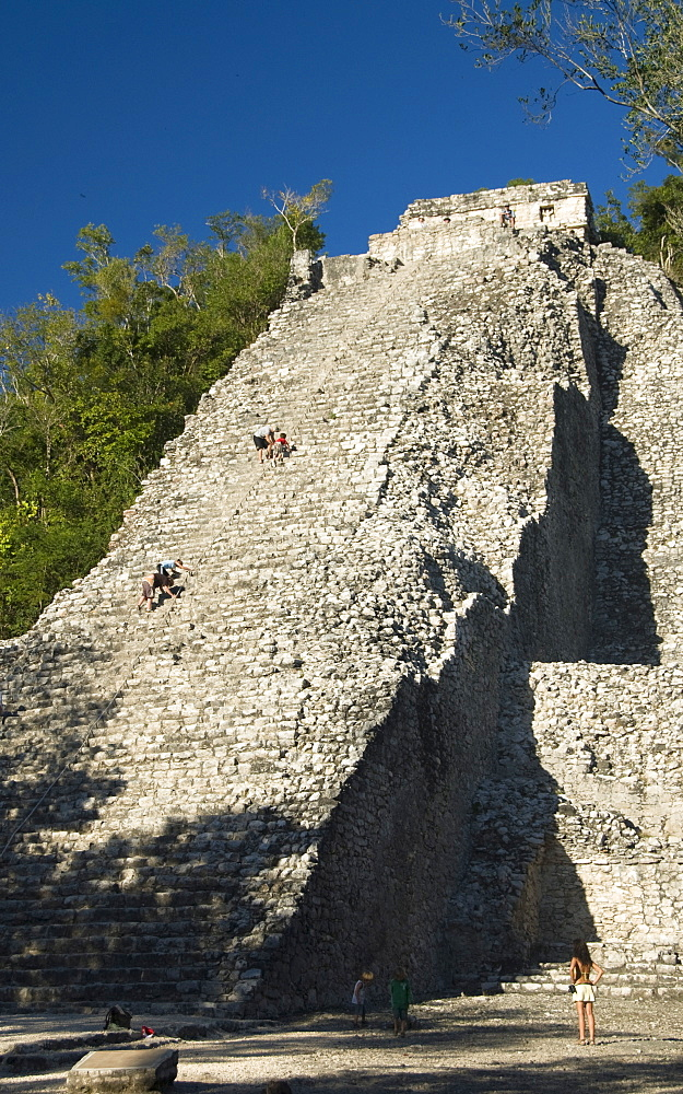 Tourists climbing the stairway, Nohoch Mul (Big Mound), Coba, Quintana Roo, Mexico, North America