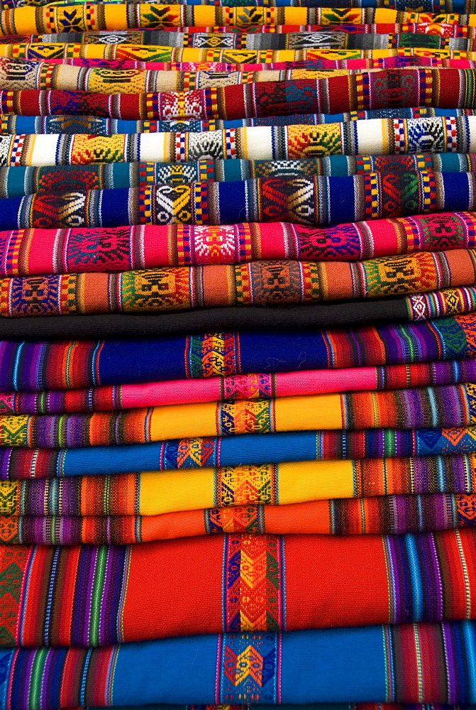Textiles for sale in the market in the village of Pisac, The Sacred Valley, Peru, South America - 801-3