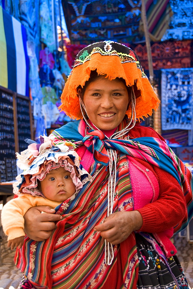 Indigenous mother with child in traditionally colorful dress, Pisac, Sacred Valley, Peru, South America - 801-30