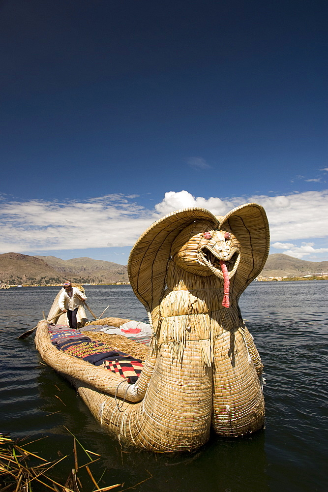 Reed boat with decorative bow, amid floating islands of the Uros people, Lake Titicaca, Peru, South America