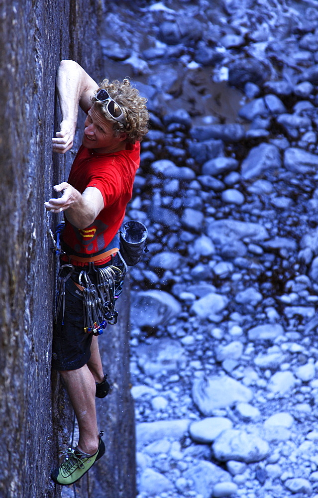 A climber tackles a sheer face using tiny fingerholds in Huntsman's Leap, near Bosherston and St. Govan's Head, Pembrokeshire Coast National Park, South Wales, Wales, United Kingdom, Europe