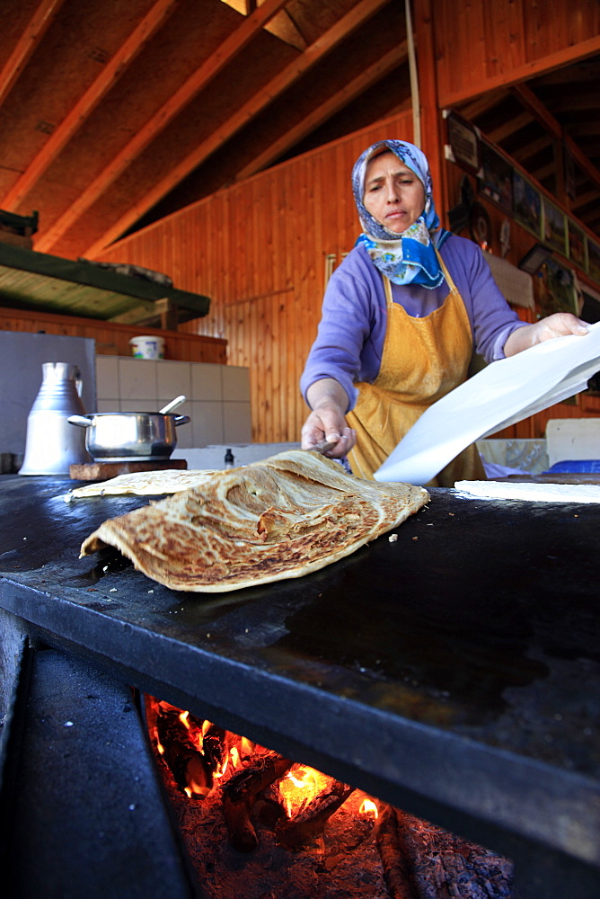 Woman making flatbread in a cafe in Antalya, Anatolia, Turkey, Asia Minor, Eurasia