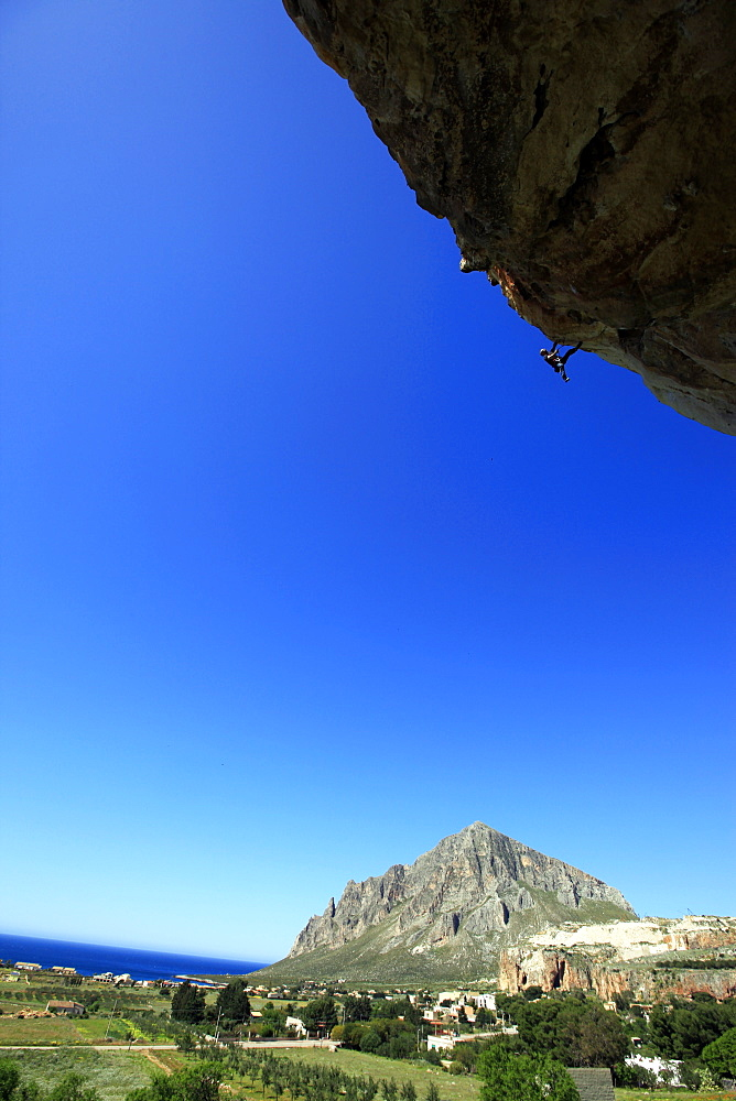 A climber scales cliffs near San Vito Lo Capo, northwest Sicily, Italy, Europe