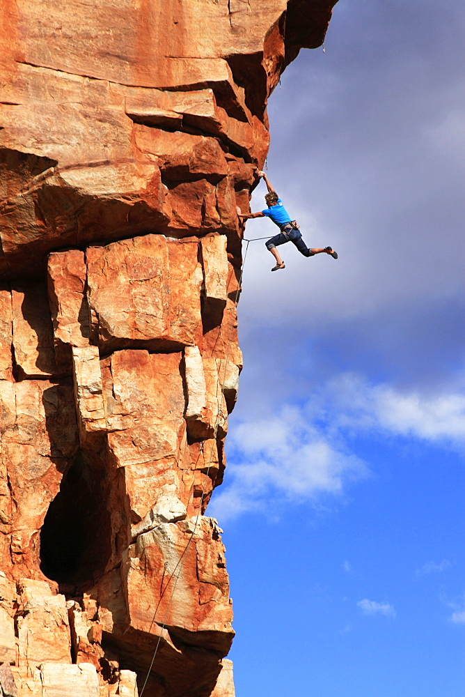 A climber on the sandstone cliffs of the Cederberg Mountains, Western Cape, South Africa, Africa - 802-281