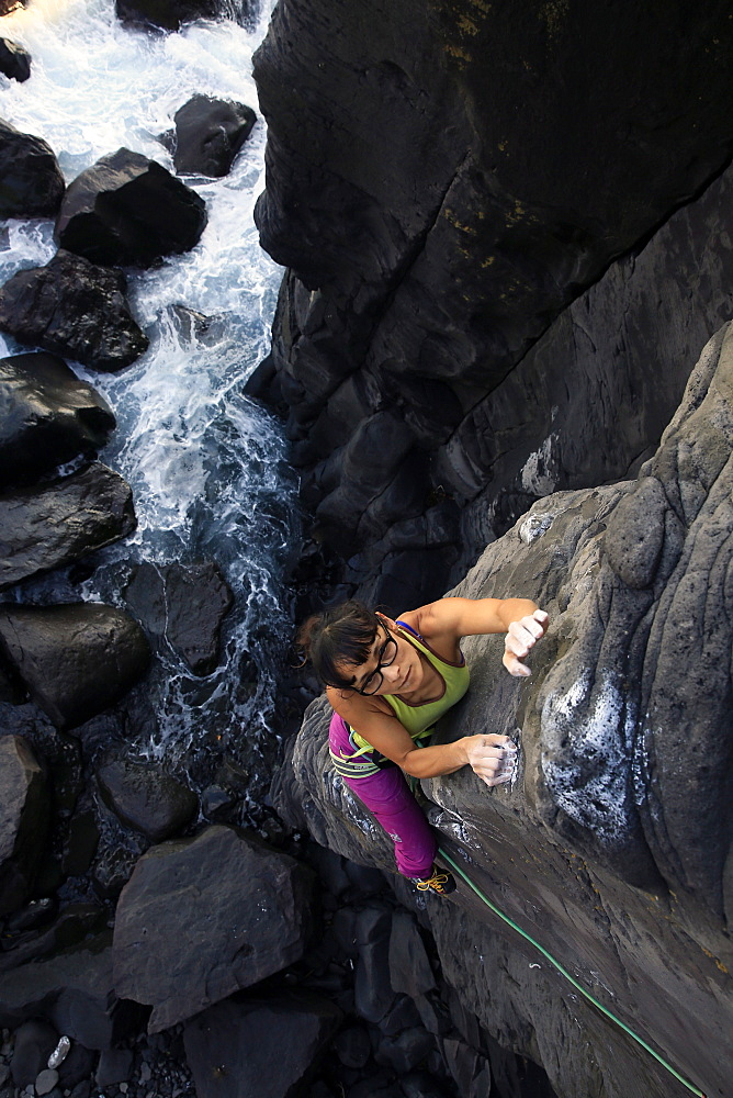 A woman rock climbing on the Jogasaki Coast, Izu Peninsula, Honshu, Japan, Asia