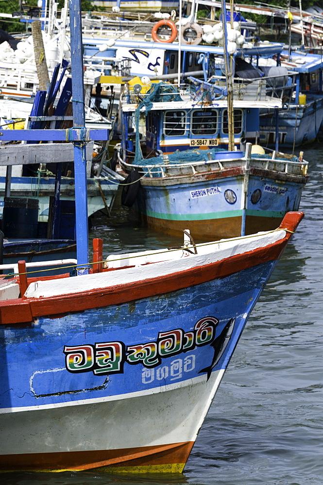 Brightly coloured fishing boat at Negombo lagoon, Negombo, Sri Lanka, Asia