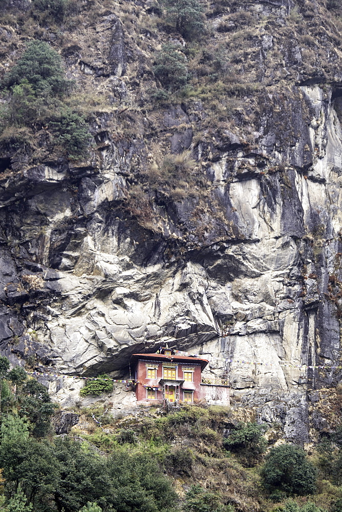 An old religious building built into the side of a cliff in the  Sagarmatha National Park UNESCO World Heritage Site, Himalayas, Nepal, Asia - 803-196