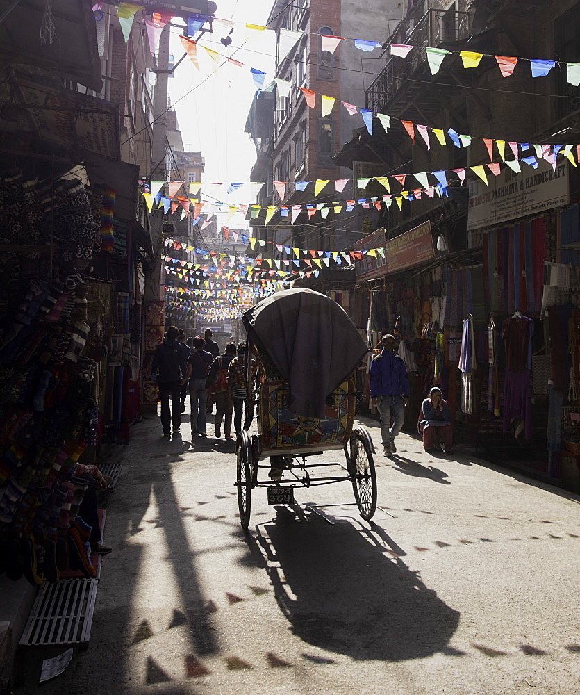 A rickshaw driving through the streets of Kathmandu, Nepal, Asia