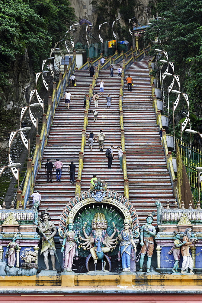Pilgrims and tourists walking up the steep steps to the Batu Caves, Gombak, Malaysia, Southeast Asia, Asia