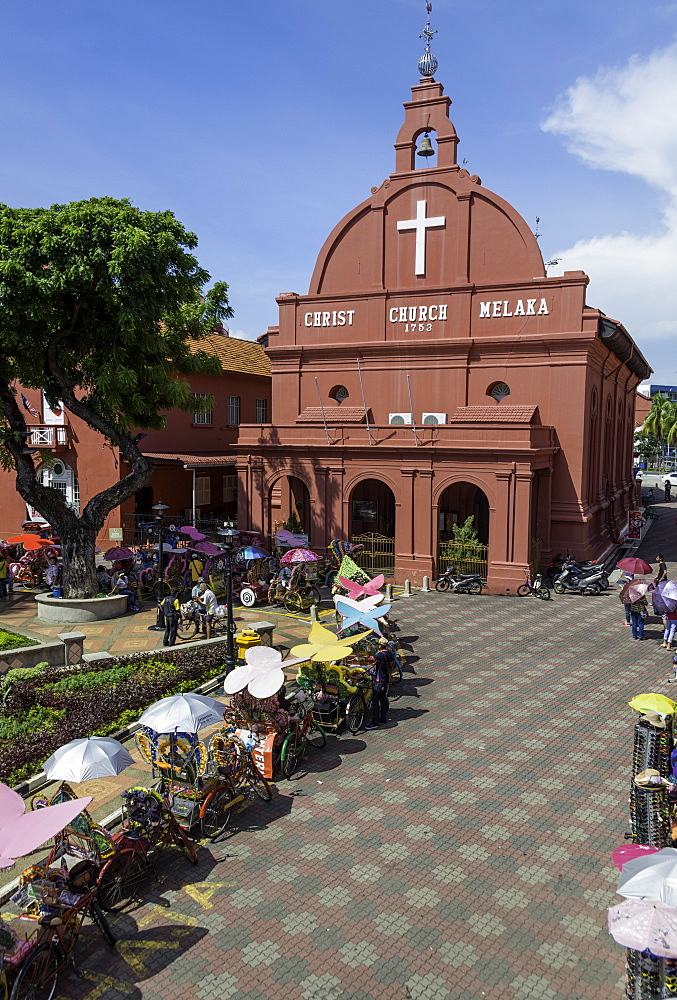 Rickshaws outside Christ Church in the town square, Melaka (Malacca), UNESCO World Heritage Site, Malaysia, Southeast Asia, Asia