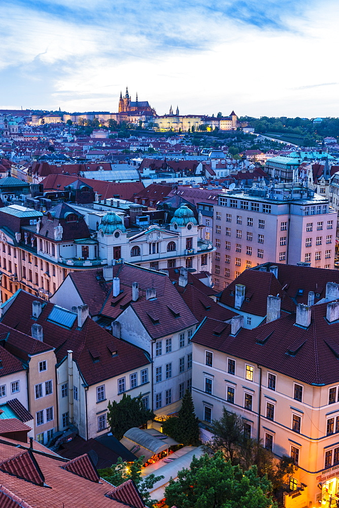 View over the Old Town rooftops towards St. Vitus's Cathedral at dusk, UNESCO World Heritage Site, Prague, Czech Republic, Europe