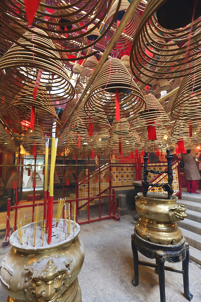 Incense coils hang from the roof of the Man Mo Temple, built in 1847, Sheung Wan, Hong Kong, China, Asia