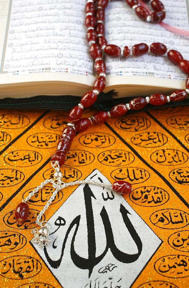 Koran, rosary and Allah calligraphy, Paris, France, Europe