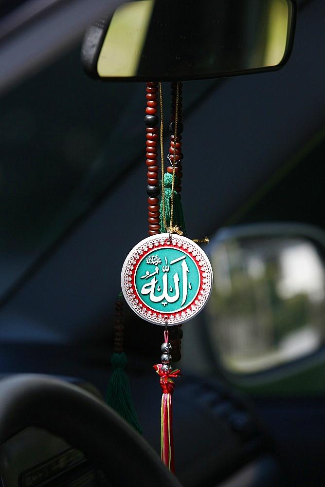 Muslim symbols in a car, Chatillon-sur-Chalaronne, Ain, France, Europe