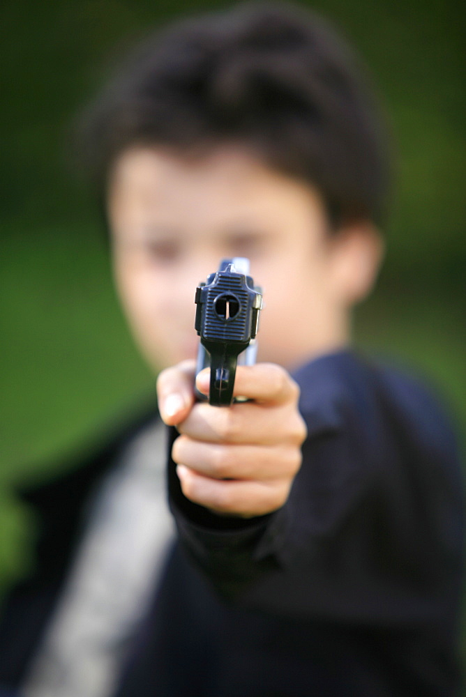 Boy with toy gun, Le Souillard, Eure, France, Europe