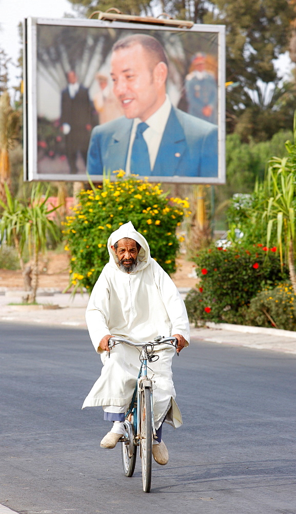 Portrait of King Mohammed VI and cyclist, Taroudan, Morocco, North Africa, Africa