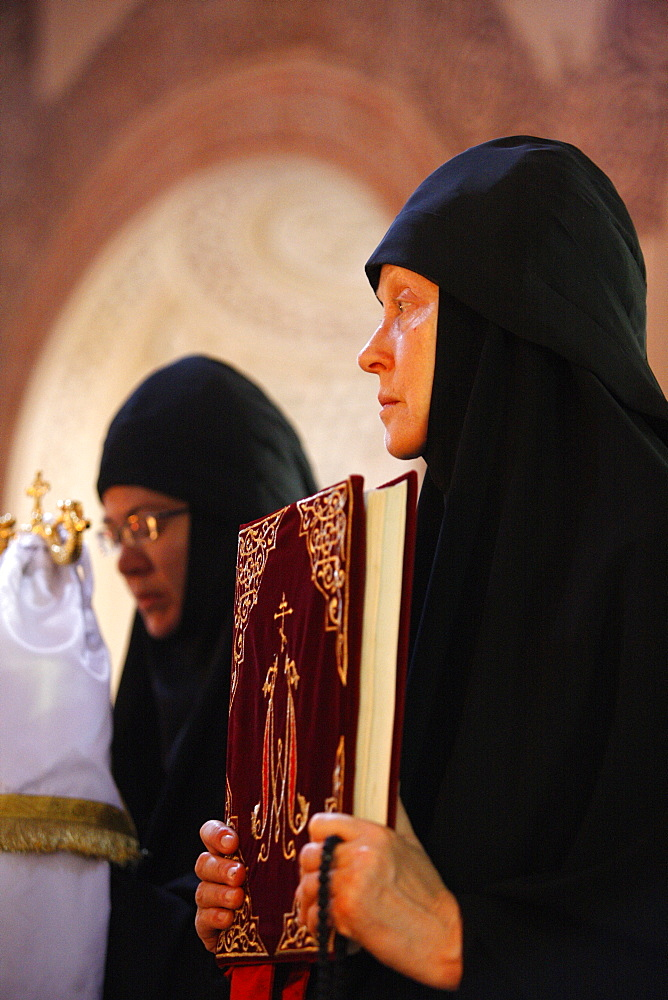 Nuns celebrating Mass in Mary Magdalene Russian Orthodox church on Mount of Olives, Jerusalem, Israel, Middle East