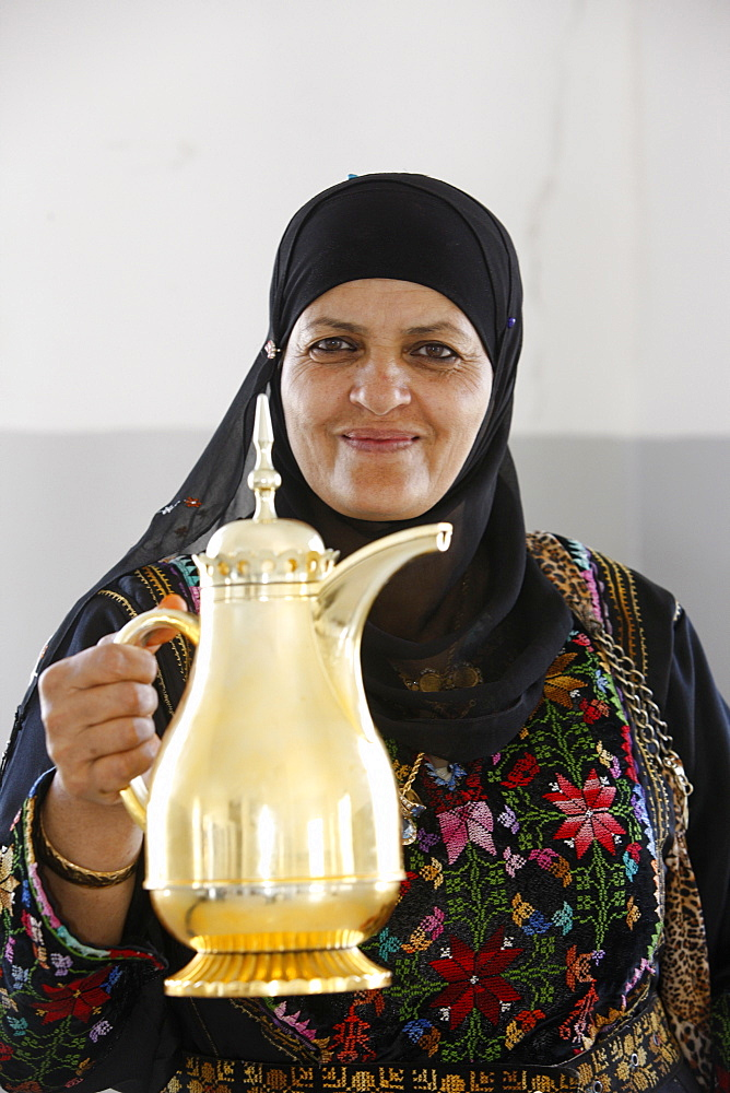 Palestinian volunteer offering coffee at the Physicians for Human Rights' mobile clinic, Souk Ba, Palestine National Authority, Middle East