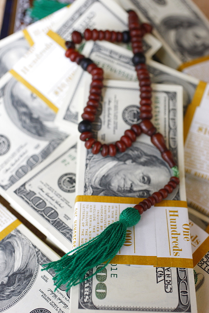Muslim prayer beads and bank notes, France, Europe