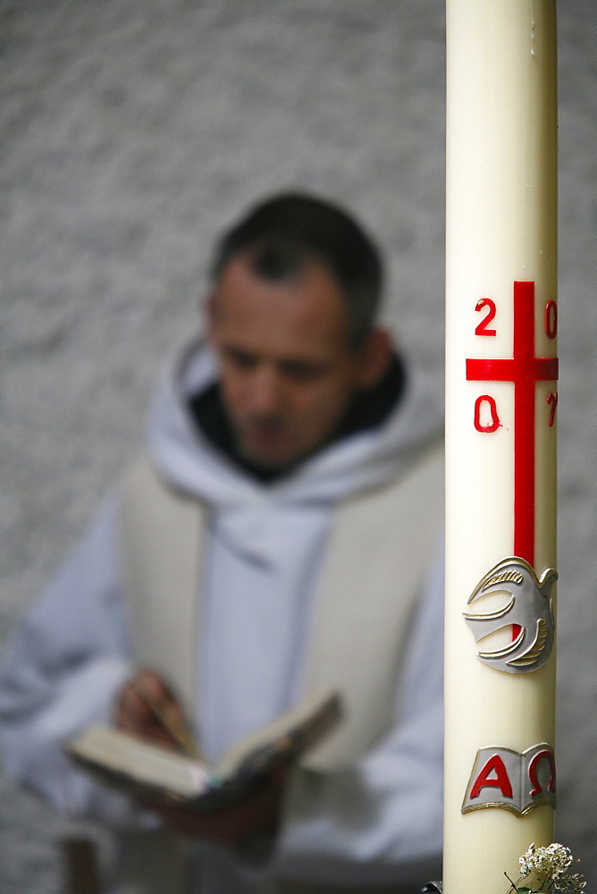 Easter candle and praying monk, Evian, Haute Savoie, France, Europe