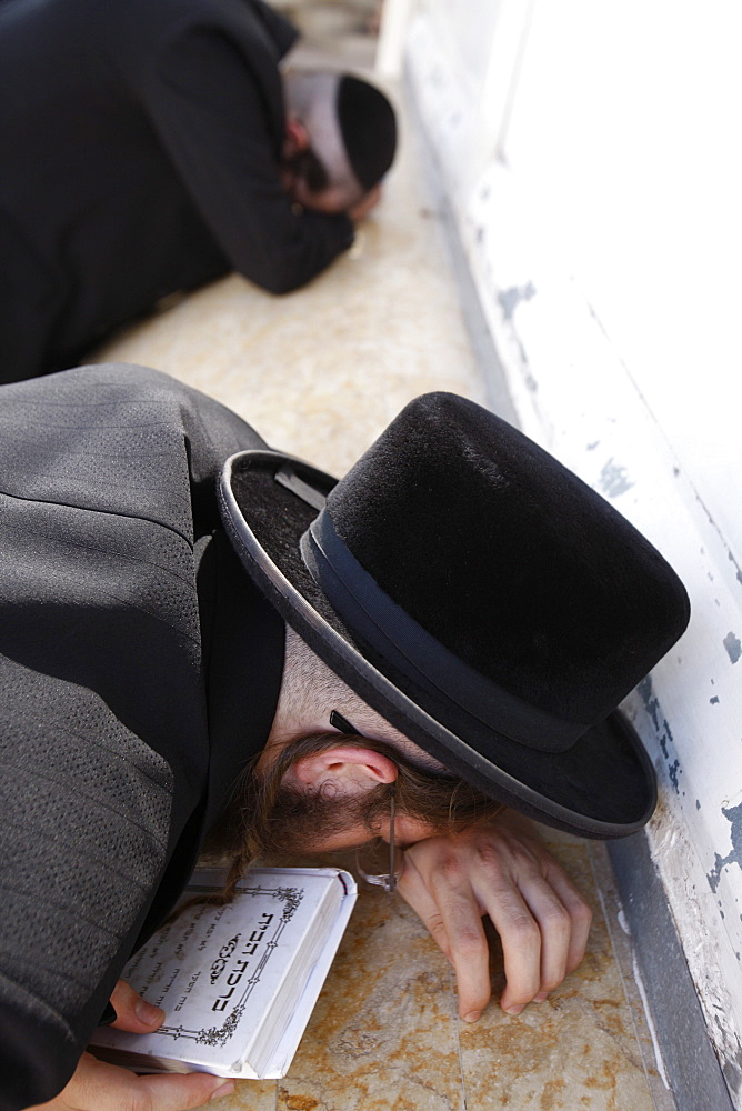 Belz Hasidic Jews praying at Maimonides' tomb in Tiberias, Galilee, Israel, Middle East