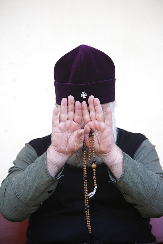 Camera-shy Orthodox priest, Yardenit, Israel, Middle East