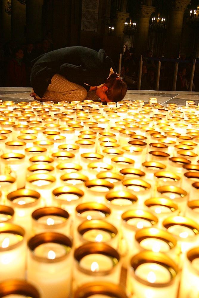 Night vigil in Notre Dame de Paris cathedral, Paris, France, Europe