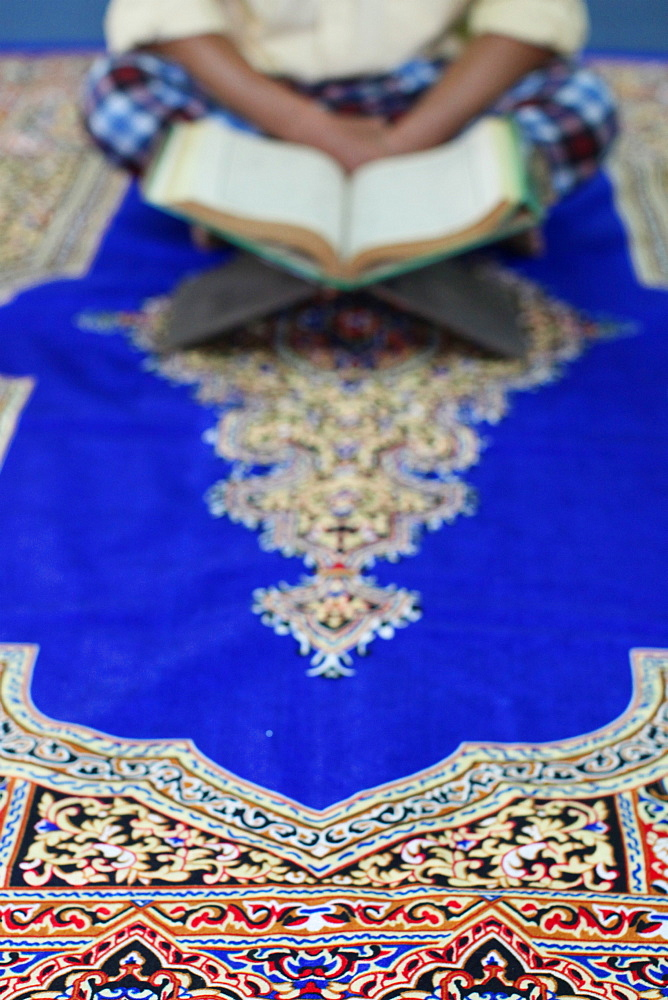 Muslim man reading the Quran in a mosque, Ho Chi Minh City, Vietnam, Indochina, Southeast Asia, Asia