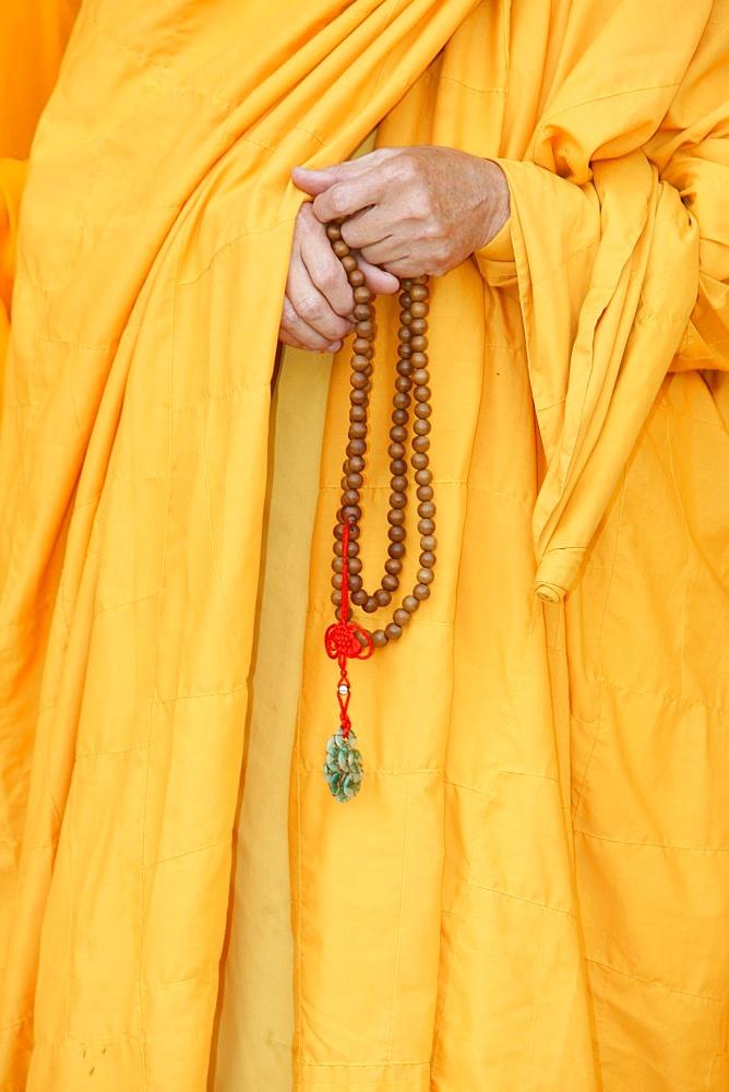Buddhist monk holding prayer beads, Thiais, Val de Marne, France, Europe