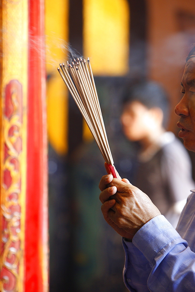 Burning incense during Tet, the Vietnamese lunar New Year celebration, Thien Hau Temple, Ho Chi Minh City, Vietnam, Indochina, Southeast Asia, Asia