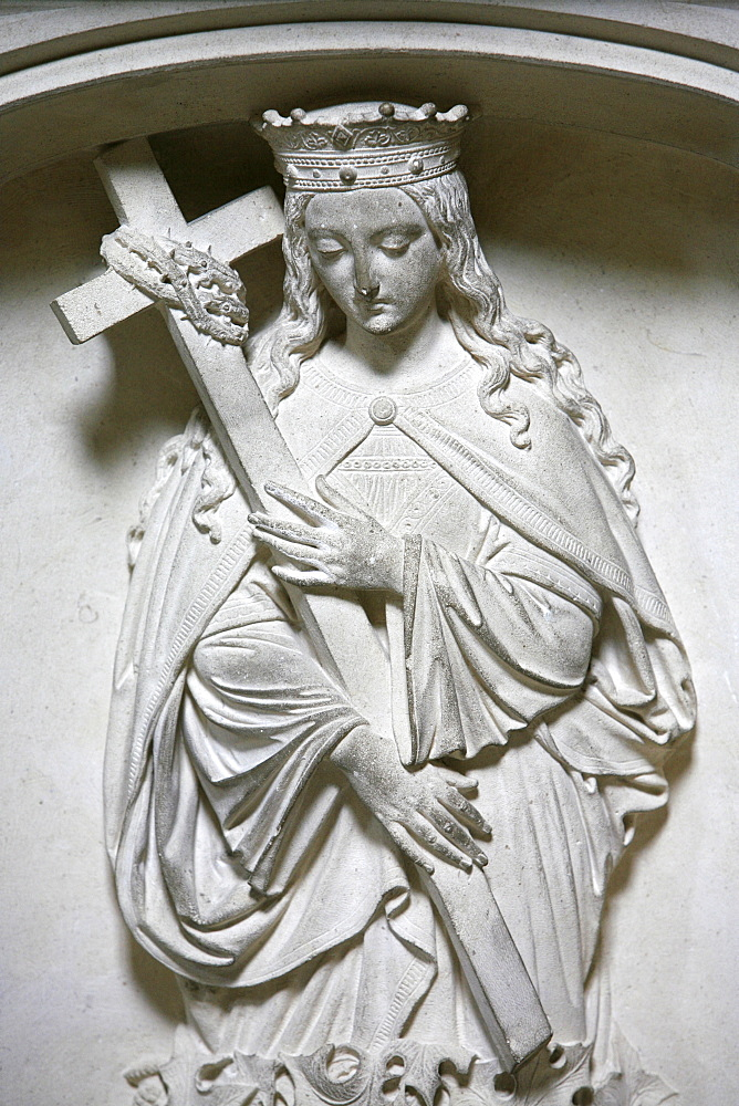 Sculpture of the crowned Virgin carrying a cross, Saint-Pierre de Solesmes Abbey, Solesmes, Sarthe, Pays de la Loire, France, Europe