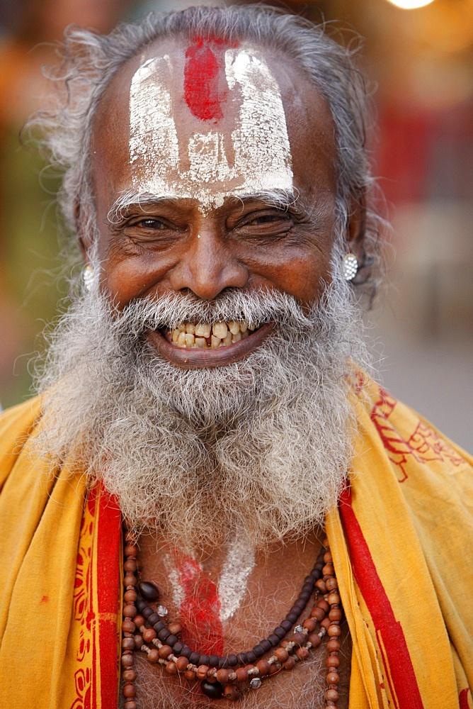 Smiling sadhu with Vishnu mark on his forehead, Rishikesh, Uttarakhand, India, Asia